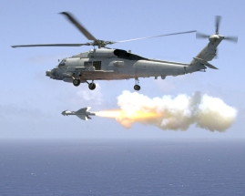020723-N-9536A-006 Pacific Ocean off the Coast of Okinawa, Japan (Jul. 23, 2002) -- Helicopter Antisubmarine Light Five One (HSL-51) fires an AGM-119 ÒPenguinÓ anti-ship missile from an SH-60B ÒSea HawkÓ helicopter, during aircrew weapon certifications. HSL-51 is home based at the forward deployed naval facility in Atsugi, Japan, with detachments operating out of Kadena Air Force Base in Okinawa. U.S. Navy photo by PhotographerÕs Mate 2nd Class Lisa Aman. (RELEASED)